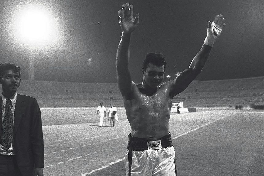 October 1973 Ali acknowledges spectators after completing a five-round exhibition bout against Tony Doyle at the National Stadium in Singapore