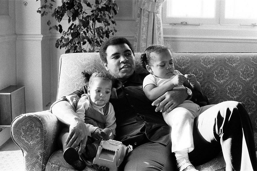 December 1978 A relaxed Ali cuddles his daughters Laila (left) and Hana.