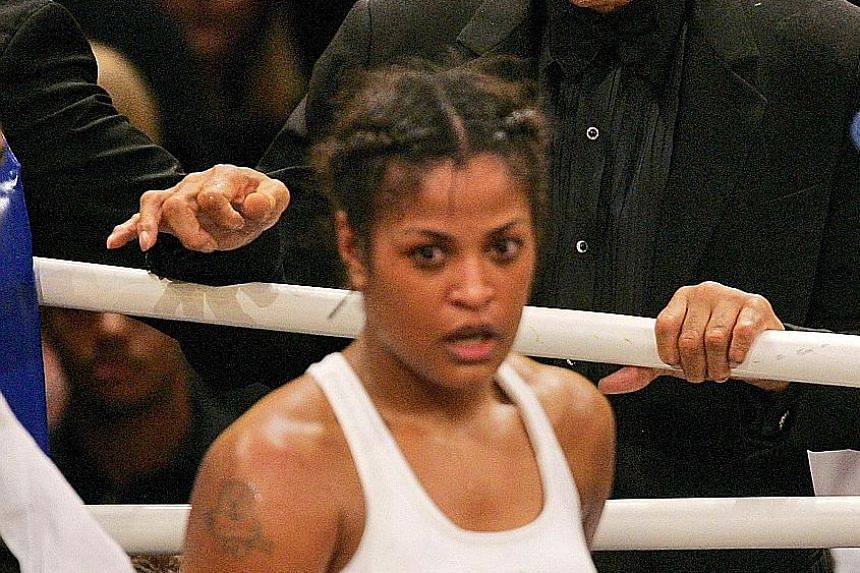 December 2005 Ali looks on after his daughter Laila defeated Asa Sandell of Sweden for the World Championship super-middleweight title.