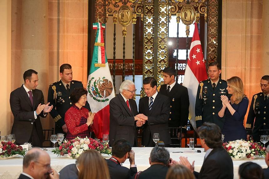 Mexican President Pena Nieto welcoming President Tan at the state luncheon at the National Palace in Mexico City. Dr Tan is accompanied by his wife, Mary (in red), while Mr Pena Nieto is accompanied by his wife Angelica Rivera (in blue).