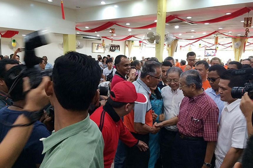 Dr Mahathir (right in picture) at a Chinese restaurant in Sekinchan, Selangor, yesterday. Sekinchan is the biggest town in Sungai Besar constituency, one of two where a by-election is being held on June 18.