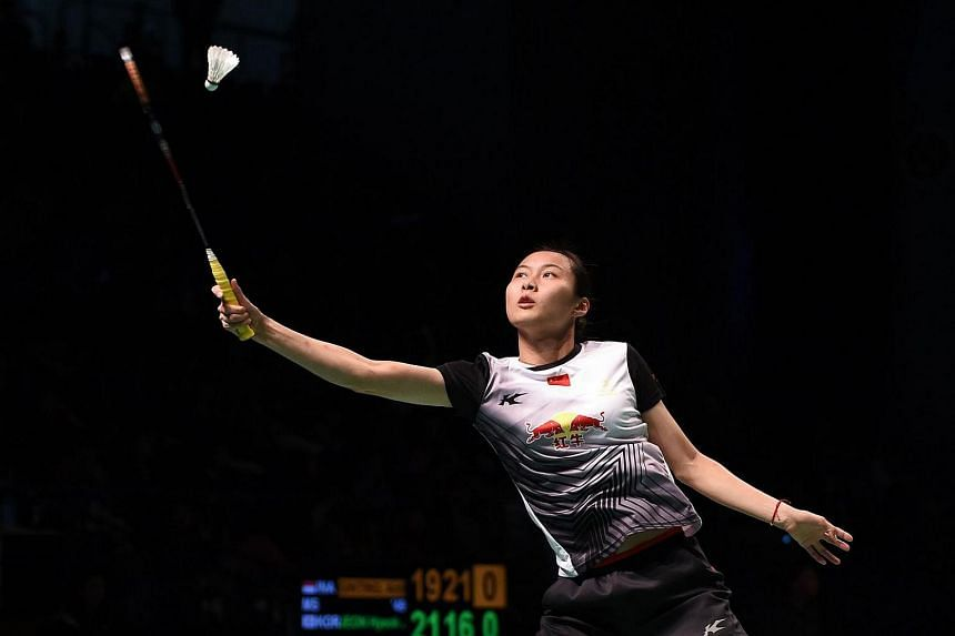 Wang Yihan of China hits a return to Saina Nehwal of India during their women's singles semi-final at the Australian Open Badminton tournament in Sydney on June 11.