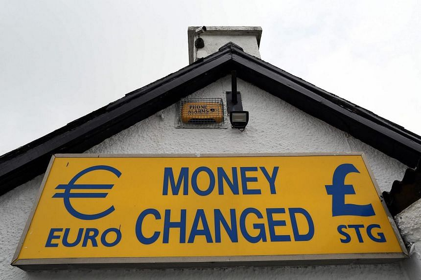"A ""money exchanged"" sign is pictured at the border between Newry in Northern Ireland and Dundalk in The Republic of Ireland."
