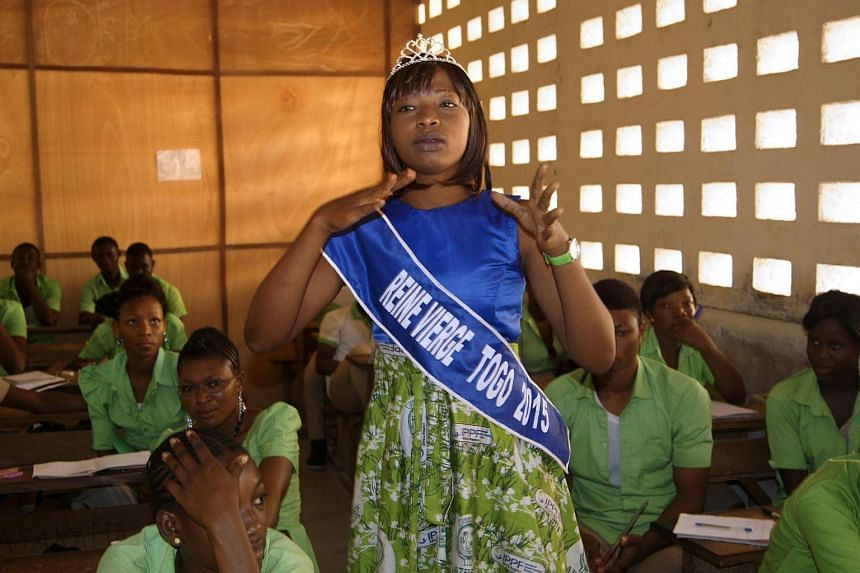 "Togo's reigning ""Virgin Queen"" Pascaline Boukari Kombaté gives a talk to students in a classroom in the capital, Lome, on February 23."