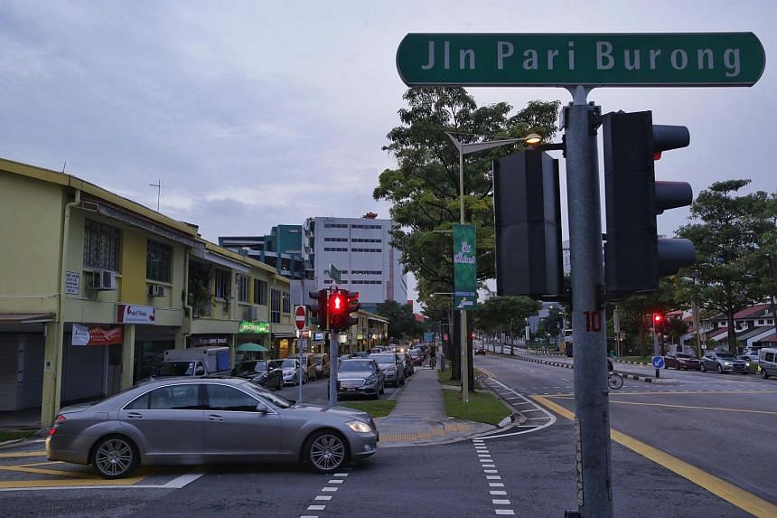 A road lined with cars on both side at Jalan Pari Burong on June 11.
