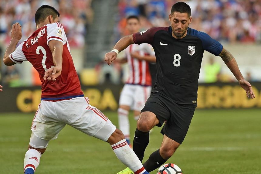 USA's Clint Dempsey (right) is marked by Paraguay's Fabian Balbuena during their Copa America football match.