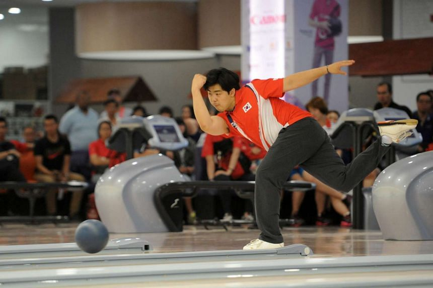 South Korea's Park Jong Woo bowling during the Singapore International Open on June 12, 2016.
