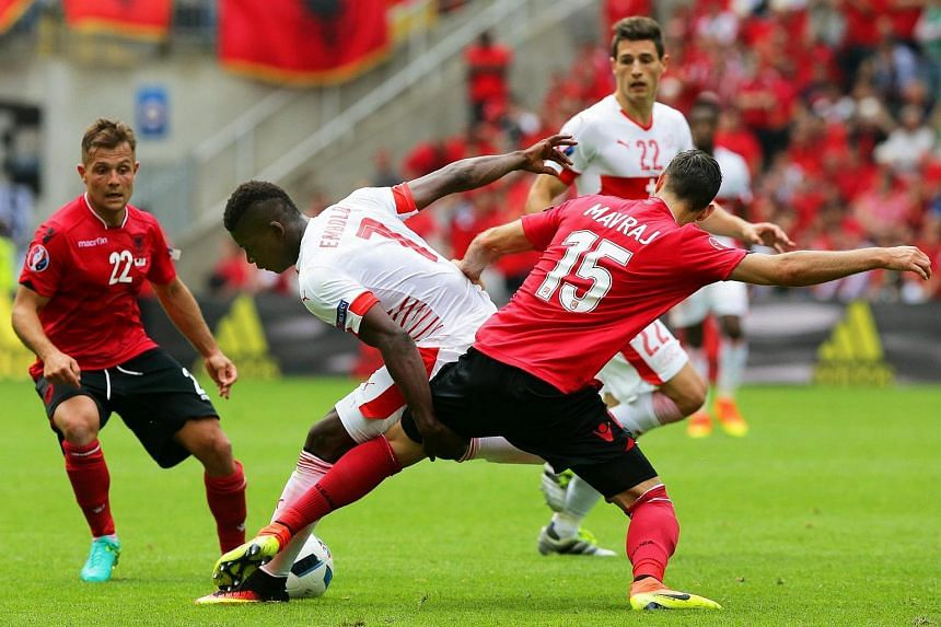 Switzerland's Breel Embolo (centre) in action against Albanian players Amir Abrashi (left) and Mergim Mavraj (right) during the Uefa Euro 2016 match between Albania and Switzerland.