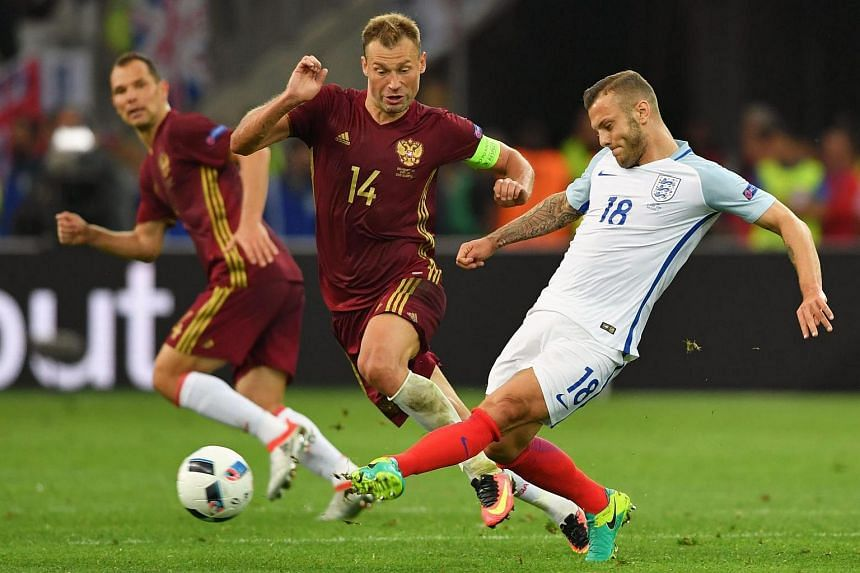 Jack Wilshere (right) of England in action against Vasili Berezutski of Russia during the Uefa Euro 2016 match between England and Russia.