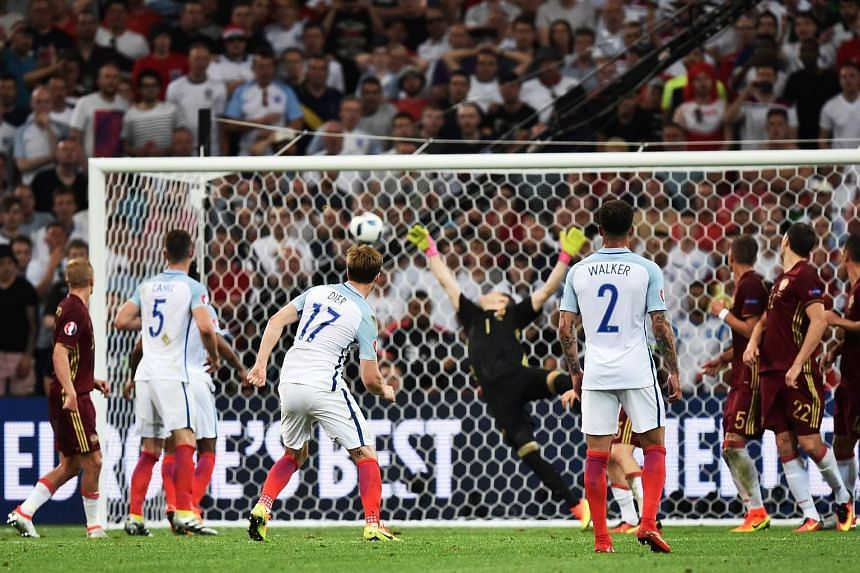 England's midfielder Eric Dier scores from a free kick  during the Euro 2016 group B football match between England and Russia.
