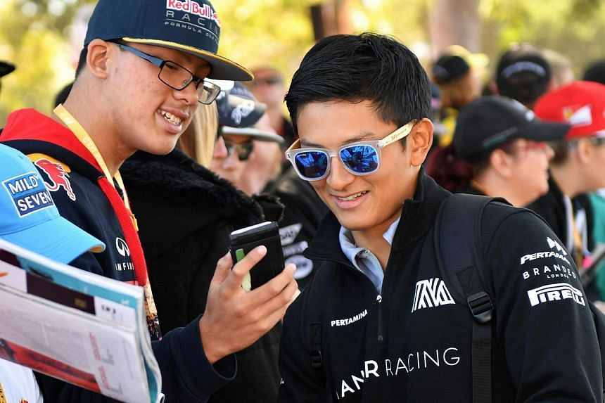 Manor F1 Team's Indonesian driver Rio Haryanto meets fans ahead of the Formula One Australian Grand Prix in Melbourne on March 20, 2016.