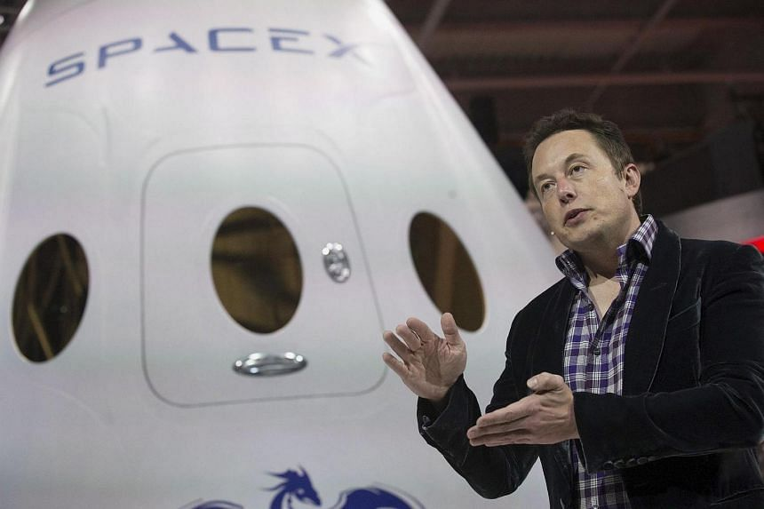 SpaceX CEO Elon Musk speaks after unveiling the Dragon V2 spacecraft in Hawthorne, California.