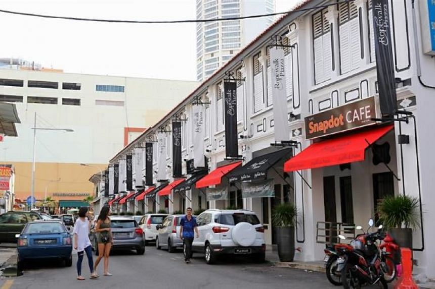 Penang's heritage property market is showing signs of overheating, with Singaporean investors snapping up shophouses by the rows.