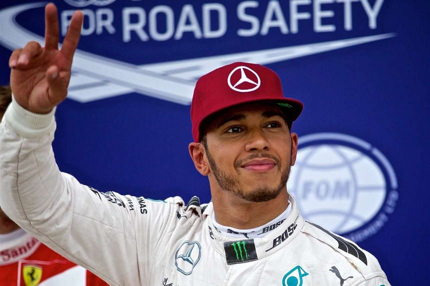Lewis Hamilton reacts after getting pole position.