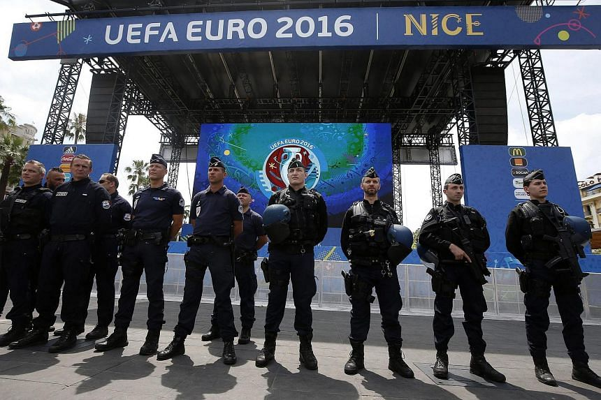 French police take part in a tour of security measures at the Uefa Euro 2016 Fan Zone, in Nice, France.