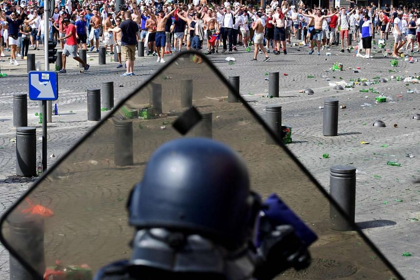 England fans clash with police personnel as England fans gather in the city of Marseille, southern France, on June 11, 2016.