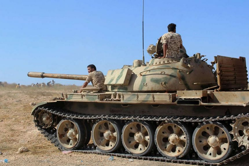 A tank belonging to forces aligned with Libya's new unity government is seen on a road as they advance on Sirte, Libya June 10, 2016.