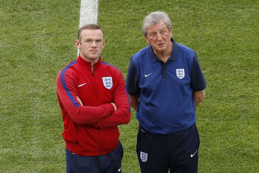 England manager Roy Hodgson (right) and Wayne Rooney walk on the pitch at the Stade Vélodrome, in Marseille, France, on June 10, 2016.