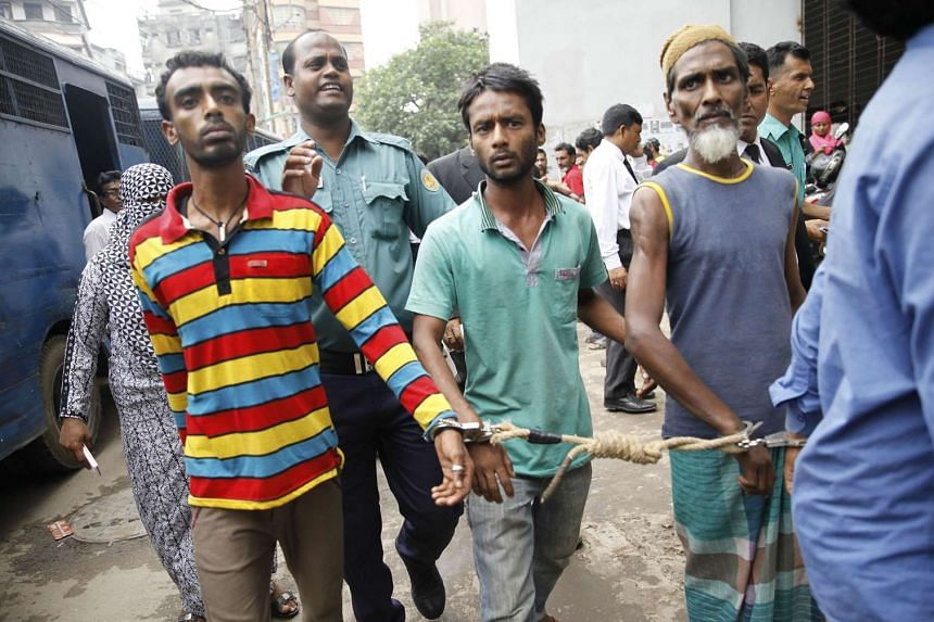 Bangladeshi police escort arrested men in Dhaka on June 12, 2016, who were detained during a nationwide anti-militant crackdown.