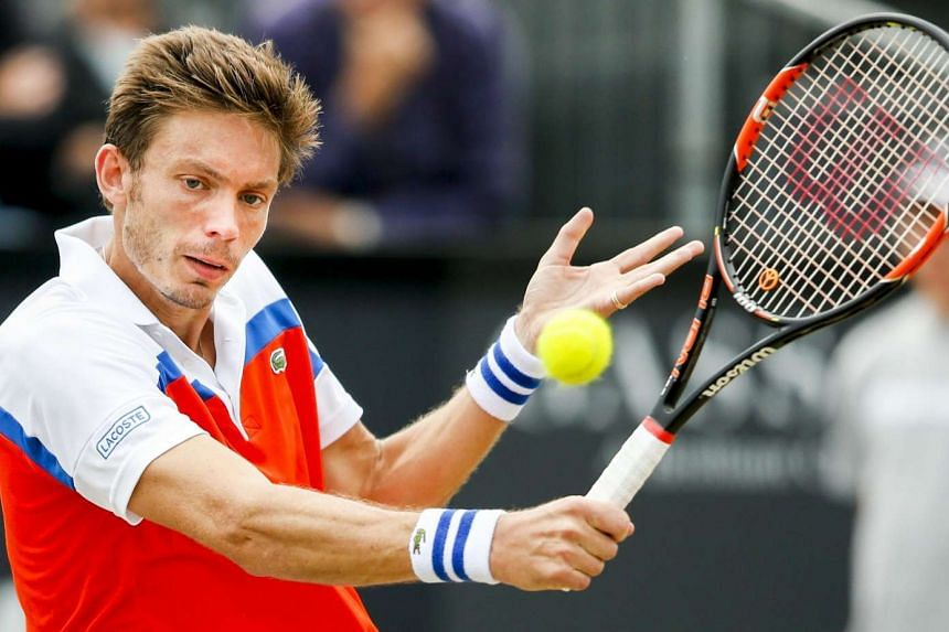 French player Nicolas Mahut returns the ball to Sam Querrey during the Ricoh Tennis Tournament semi-final match on June 11, 2016, in Rosmalen.