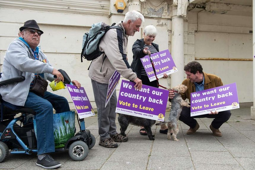 UK Independence Party supporters await the arrival of leader Nigel Farage as he goes on the campaign trail for Brexit in Ramsgate, on June 13, 2016.