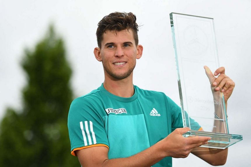 Dominic Thiem of Austria poses with the trophy after winning the final against Philipp Kohlschreiber of Germany during the ATP tournament in Stuttgart, Germany on June 13, 2016.