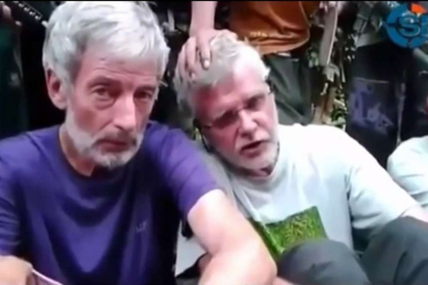 Robert Hall (left) has been killed by militant group Abu Sayyaf in the Philippines.