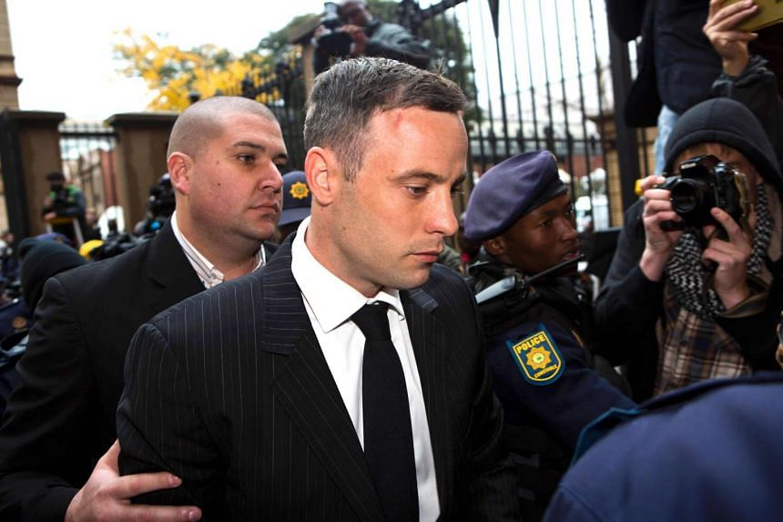 South African Paralympian Oscar Pistorius arrives at Pretoria High Court on June 13, 2016, for his sentencing hearing.