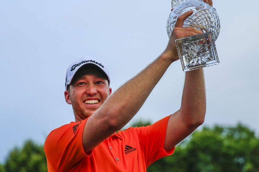 Daniel Berger of the US raises his trophy after winning the FedEx St Jude Classic in Memphis, Tennessee, on June 12, 2016.