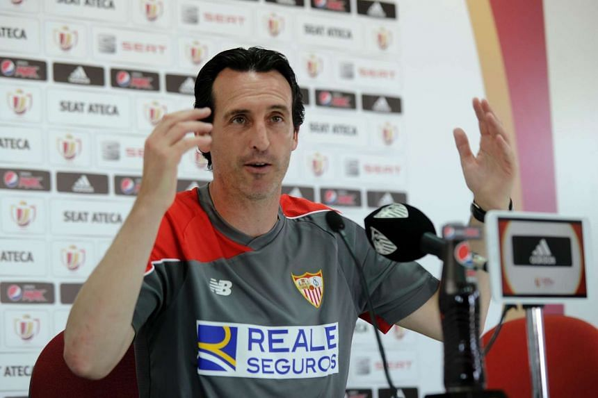 Sevilla's coach Unai Emery gestures at a press conference after a training session, on May 21, 2016.