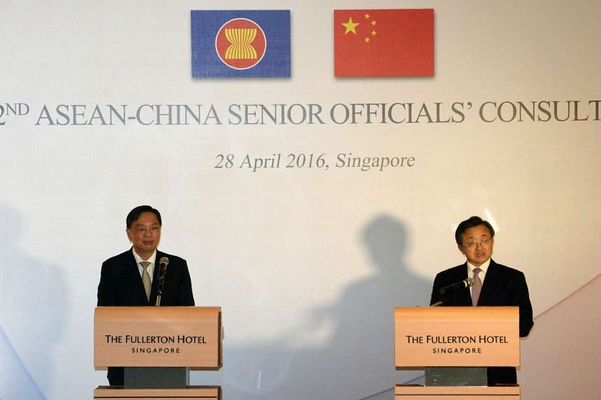 China's Foreign Affairs Vice Minister Liu Zhenmin (right) and Singapore's Foreign Affairs Permanent Secretary Chee Wee Kiong after the 22nd ASEAN-China Senior Officials' Consultations meeting, on April 28, 2016.