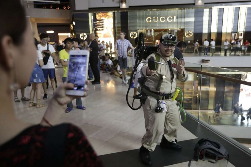 A fan dressed up as a ghostbuster at Marina Bay Sands on June 12, 2016.