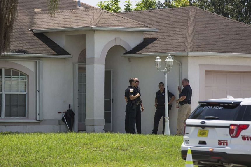 Police stand outside a home related to suspected Orlando club shooter Omar Mateen in Port St. Lucie, Florida, USA, on June 12, 2016.
