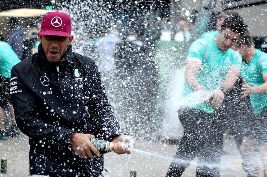 Lewis Hamilton of Great Britain and Mercedes GP celebrates his win with his team during the Canadian Formula One Grand Prix at Circuit Gilles Villeneuve on June 12, 2016 in Montreal, Canada.