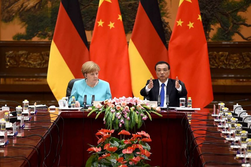 German Chancellor Angela Merkel and Chinese Premier Li Keqiang attending a meeting at the Great Hall of the People in Beijing on June 13, 2016. Dr Merkel is on a visit to China from June 12 to June 14.