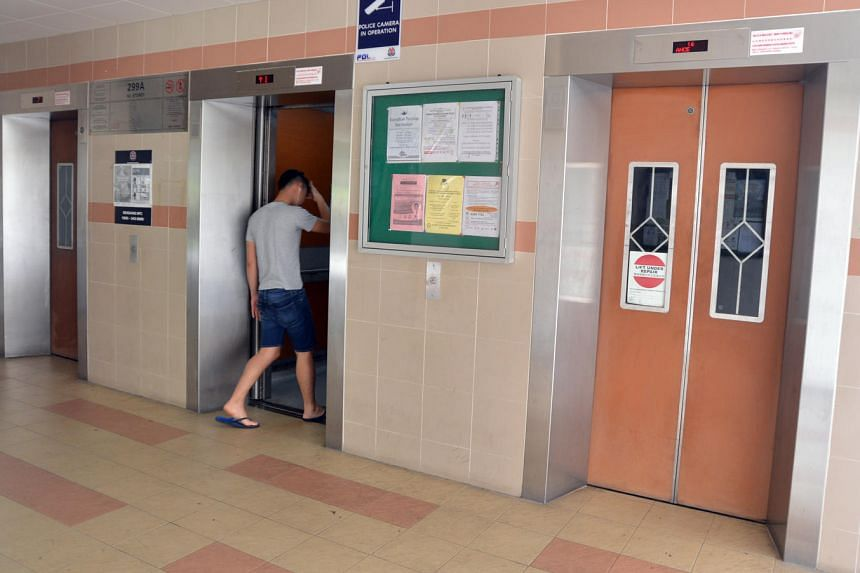 Residents using lift A and B while lift C continues to malfunction at Block 299A Compassvale Street, on June 13, 2016.