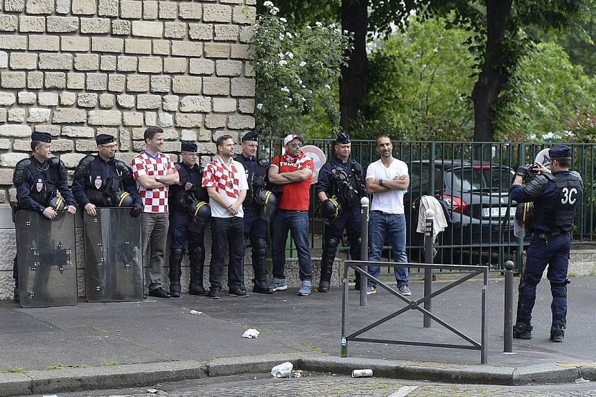 Croatia supporters seizing the day for photograph opportunities with French riot police, in a marked contrast to fan violence that marred the England-Russia game.