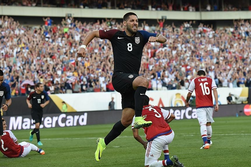 Clint Dempsey celebrates after scoring the winner for the US against Paraguay. The Americans' 1-0 win mean they enter the knockout stage as winners of their group, potentially avoiding a quarter-final showdown with tournament heavyweights Brazil.