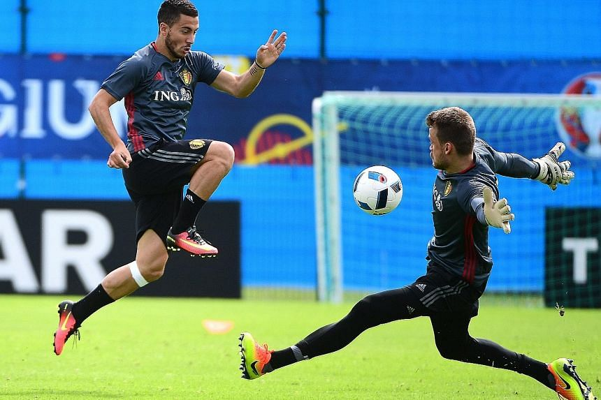 Belgium forward Eden Hazard (left) goes one on one with goalkeeper Simon Mignolet in training. While Belgium have beaten Italy just four times in 21 meetings, they beat the Azzurri 3-1 in a friendly in Brussels in November.