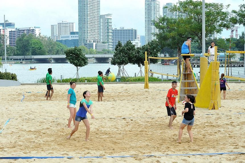While beach volleyball (above) was one of the many attractions at the inaugural Sports Hub Community Play Day last Saturday, people of all ages tried their hand at speedminton, a modified version of traditional badminton.