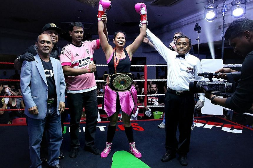 Singapore's only professional woman boxer, Nurshahidah Roslie, after winning her Universal Boxing Organisation intercontinental super featherweight title on Friday. She beat Thai Wondergirl Sithsaithong.