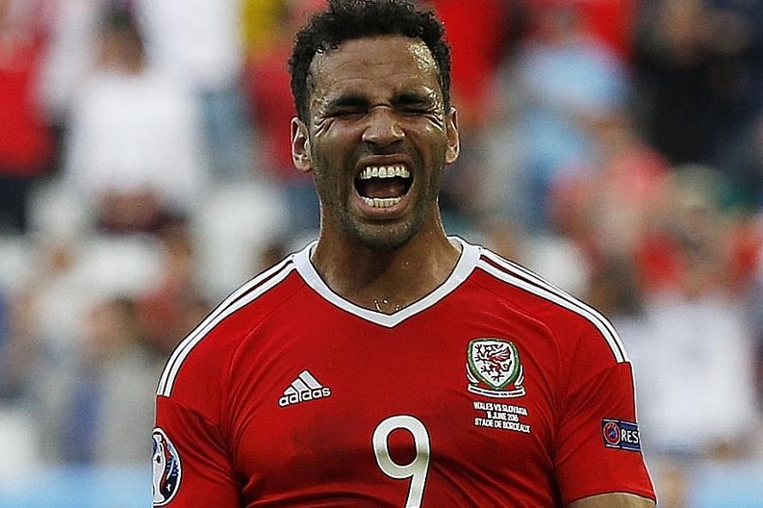Hal Robson-Kanu celebrating after helping Wales to a 2-1 win over Group B rivals Slovakia.