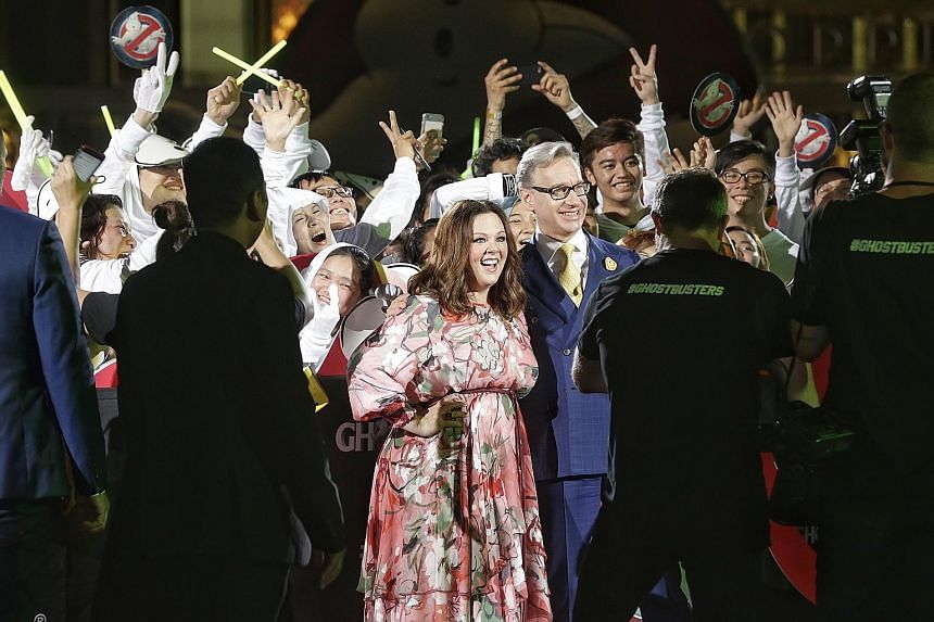 Oscar-nominated comedienne Melissa McCarthy and director Paul Feig (centre) were at the Marina Bay Sands event plaza last night for a red carpet event to celebrate the all-female remake of Ghostbusters. McCarthy plays paranormal expert Abby Yates in