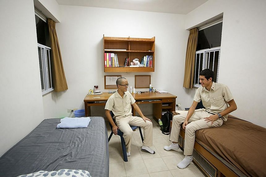 Secondary 4 students Teh Hong Yi (left) and Irving de Boer, both 16, in their room at Hwa Chong Institution Boarding School. HCI student Dragon Chew, 16, is one of 20 Secondary 4 students who chose to continue staying at the boarding school after a s