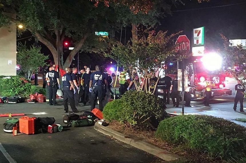 Police cars and other emergency vehicles rushed to the Pulse nightclub in Orlando yesterday as the attack unfolded over three hours. A police Swat team had to storm the venue to rescue hostages, and the gunman was later identified as Omar Mateen, a 2