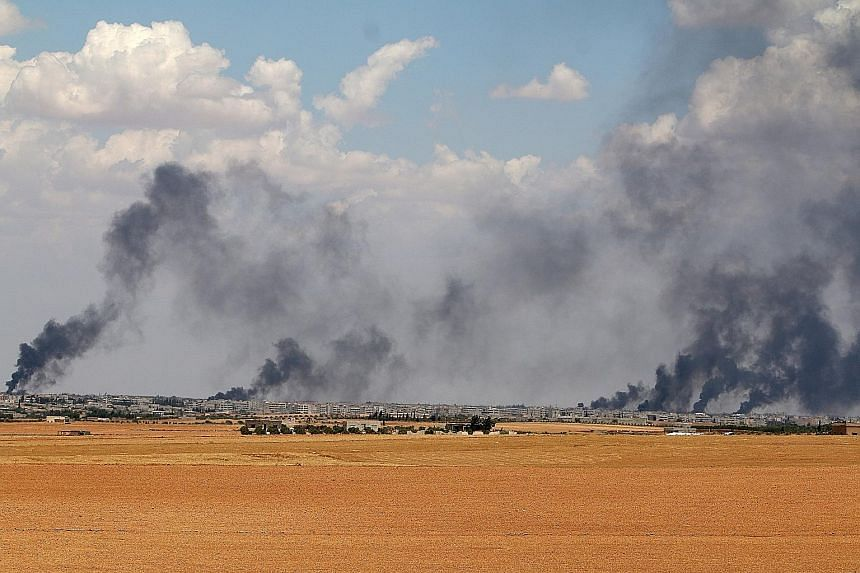 Smoke rising from Manbij in Aleppo on Wednesday. The town, which lies at the heart of the last stretch of ISIS-controlled territory along Turkey's border, was encircled by Syrian Democratic Forces troops on Friday.