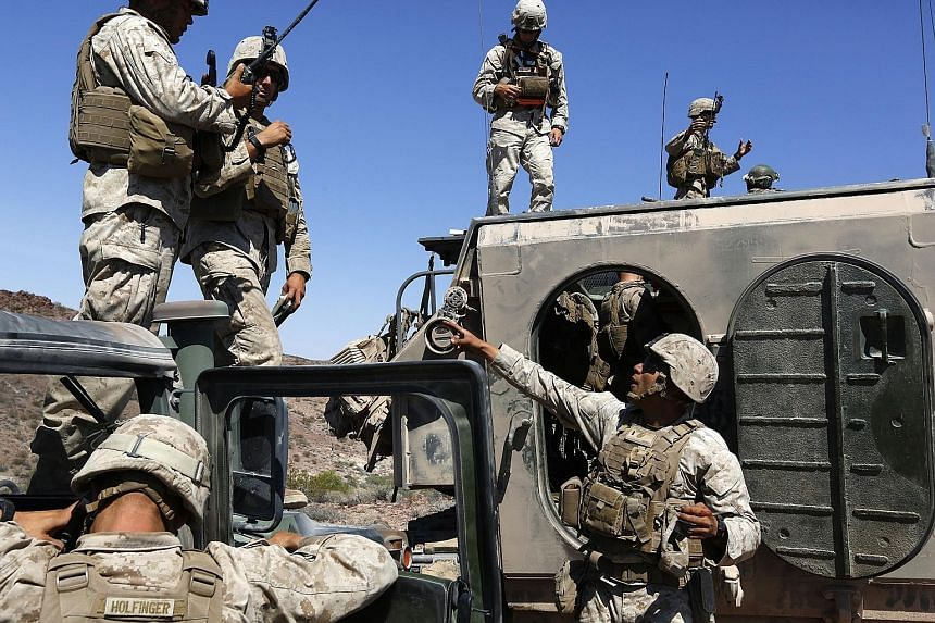 Marines coordinating airstrikes and ground troop movement during an exercise at Twentynine Palms earlier this month. The armed forces are learning how to fight what the Pentagon calls the hybrid wars of the future.