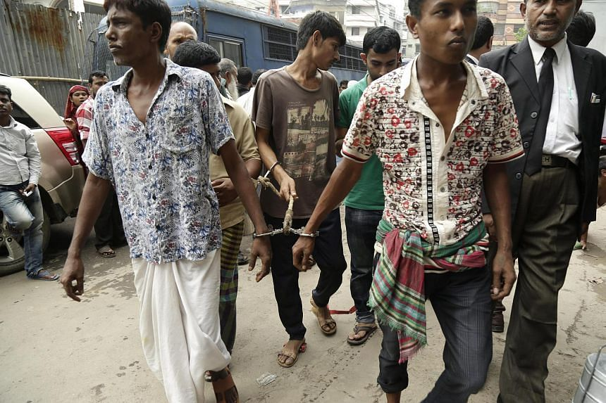 Four men move towards the court as they have been arrested during the anti-terror crackdown across the country in Dhaka, Bangladesh, on June 12.