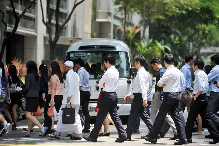 Office workers crossing the road at Market Street in Tanjong Pagar on Sep 8, 2014.