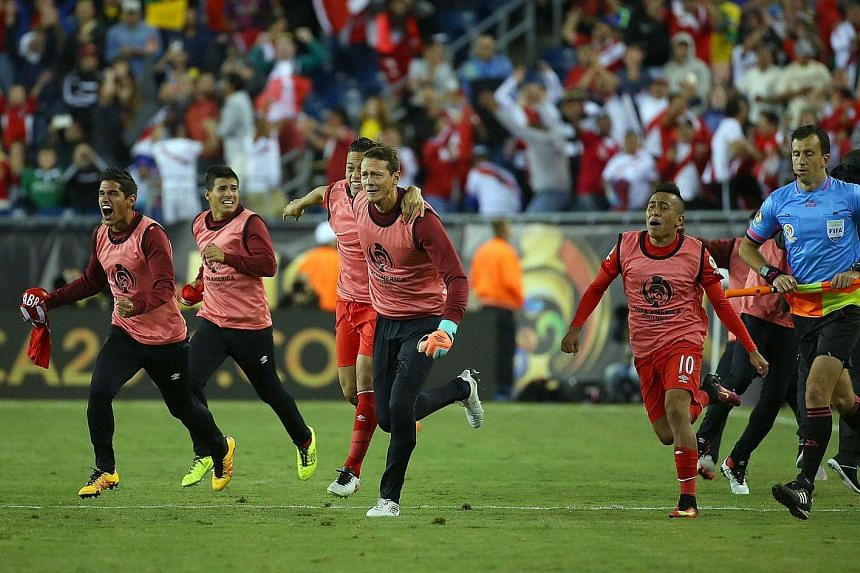 Members of Peru celebrate after winning the 2016 Copa America Centenario Group B match against Brazil at Gillette Stadium on June 12 in Foxboro, Massachusetts.